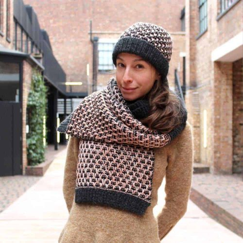 lady wearing a hat and scarf made using a knitting kit